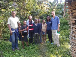 Simeon (far left), Samuel (stripy t-shirt), myself (far right), and a Baka family